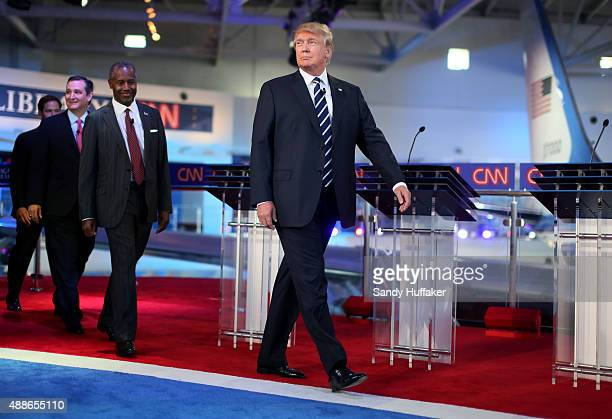 Republican presidential candidates Donald Trump Ben Carson and Ted Cruz walk onstage during the Republican presidential debates at the Reagan Library...