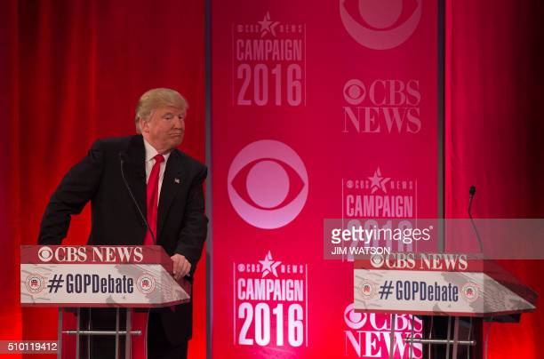 Republican presidential candidates Donald Trump poses behind his podium following the CBS News Republican Presidential Debate in Greenville South...