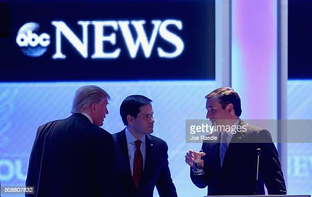 Republican presidential candidates Donald Trump Sen Marco Rubio and Sen Ted Cruz talk during a commercial break in the Republican presidential debate...