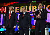 Republican presidential candidates Donald Trump Sen Ted Cruz and Jeb Bush stand on stage during the CNN presidential debate at The Venetian Las Vegas...