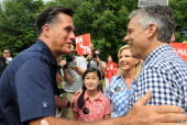 Republican presidential candidates Former Ambassador to China Jon Huntsman and former Massachusetts governor Mitt Romney greet to each other prior to...
