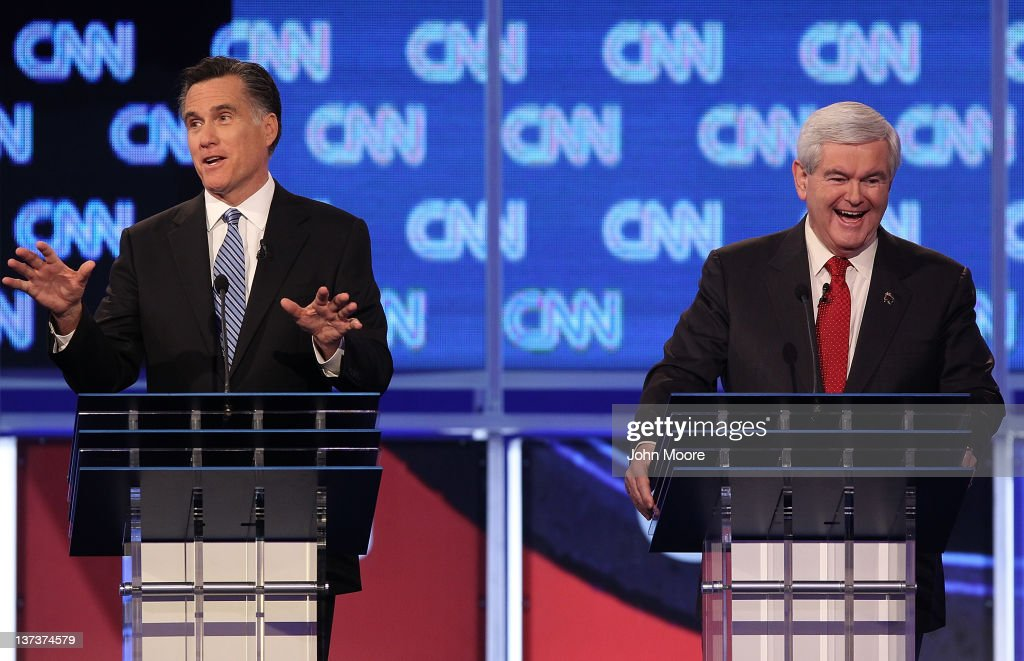 Republican presidential candidates former Massachusetts Gov. <a gi-track='captionPersonalityLinkClicked' href=/galleries/search?phrase=Mitt+Romney&family=editorial&specificpeople=207106 ng-click='$event.stopPropagation()'>Mitt Romney</a> (L) makes a point as former Speaker of the House <a gi-track='captionPersonalityLinkClicked' href=/galleries/search?phrase=Newt+Gingrich&family=editorial&specificpeople=202915 ng-click='$event.stopPropagation()'>Newt Gingrich</a> laughs during a debate at the North Charleston Coliseum January 19, 2012 in Charleston, South Carolina. The debate, hosted by CNN and the Southern Republican Leadership Conference, is the final debate before South Carolina voters head to the polls for their primary January 21.