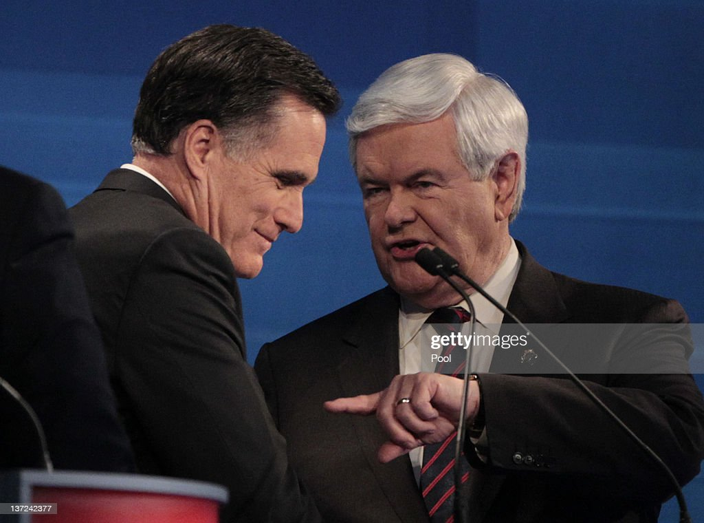 Republican presidential candidates (L-R) former Massachusetts Gov. Mitt Romney and former U.S. House Speaker Newt Gingrich talk after a Fox News, Wall Street Journal-sponsored debate at the Myrtle Beach Convention Center on January 16, 2012 in Myrtle Beach, South Carolina. Voters in South Carolina will head to the polls on January 21 to vote in the Republican primary election to pick their choice for U.S. presidential candidate.