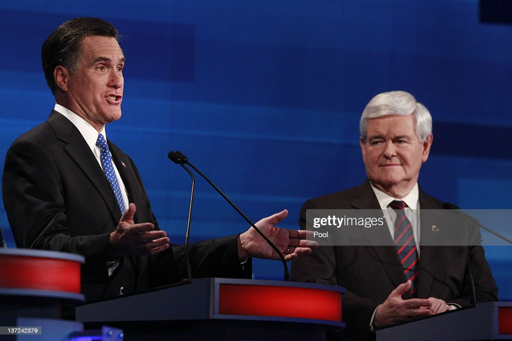 Republican presidential candidates (L-R) former Massachusetts Gov. Mitt Romney and former U.S. House Speaker Newt Gingrich participate in a Fox News, Wall Street Journal-sponsored debate at the Myrtle Beach Convention Center on January 16, 2012 in Myrtle Beach, South Carolina. Voters in South Carolina will head to the polls on January 21 to vote in the Republican primary election to pick their choice for U.S. presidential candidate.