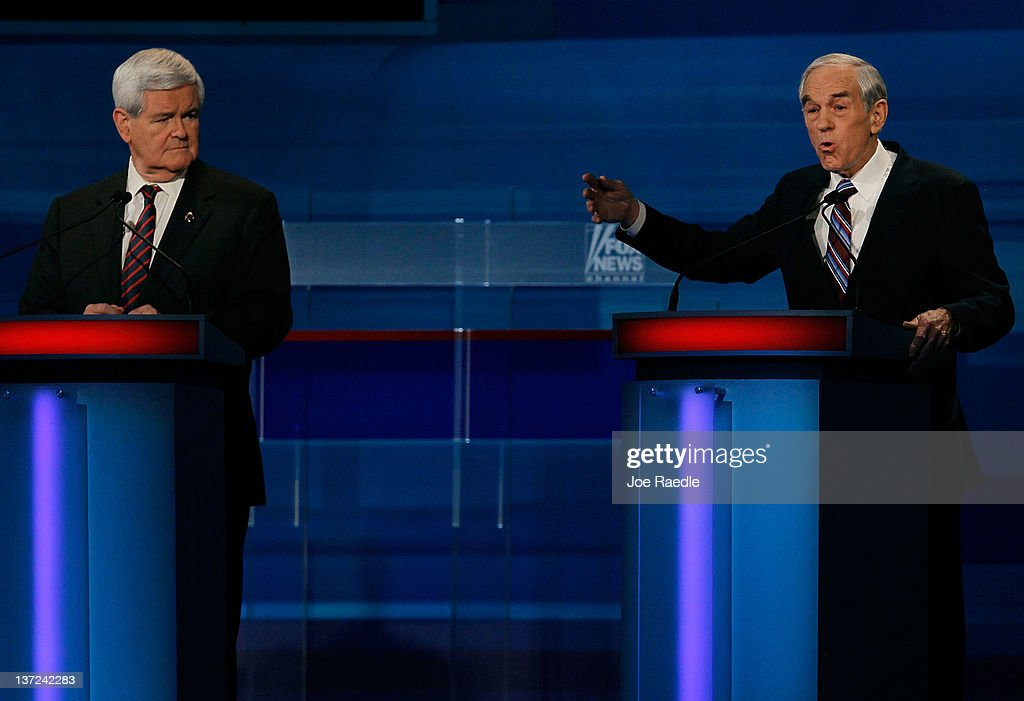 Republican presidential candidates, former U.S. House Speaker Newt Gingrich (R-GA) listens to U.S. Rep. Ron Paul (R-TX), speak during a Fox News, Wall Street Journal sponsored debate at the Myrtle Beach Convention Center, on January 16, 2012 in Myrtle Beach, South Carolina. Voters in South Carolina will head to the polls on January 21st. to vote in the Republican primary election to pick their choice for U.S. presidential candidate.