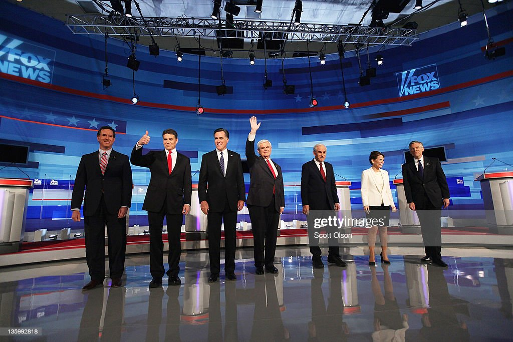 Republican presidential candidates (L-R) former U.S. Senator <a gi-track='captionPersonalityLinkClicked' href=/galleries/search?phrase=Rick+Santorum&family=editorial&specificpeople=212911 ng-click='$event.stopPropagation()'>Rick Santorum</a> (R-PA), Texas Gov. <a gi-track='captionPersonalityLinkClicked' href=/galleries/search?phrase=Rick+Perry+-+Politiker&family=editorial&specificpeople=175872 ng-click='$event.stopPropagation()'>Rick Perry</a>, former Massachusetts Gov. <a gi-track='captionPersonalityLinkClicked' href=/galleries/search?phrase=Mitt+Romney&family=editorial&specificpeople=207106 ng-click='$event.stopPropagation()'>Mitt Romney</a>, former Speaker of the House <a gi-track='captionPersonalityLinkClicked' href=/galleries/search?phrase=Newt+Gingrich&family=editorial&specificpeople=202915 ng-click='$event.stopPropagation()'>Newt Gingrich</a>, U.S. Rep. <a gi-track='captionPersonalityLinkClicked' href=/galleries/search?phrase=Ron+Paul&family=editorial&specificpeople=2300665 ng-click='$event.stopPropagation()'>Ron Paul</a> (R-TX), U.S. Rep. <a gi-track='captionPersonalityLinkClicked' href=/galleries/search?phrase=Michele+Bachmann&family=editorial&specificpeople=5578664 ng-click='$event.stopPropagation()'>Michele Bachmann</a> (R-MN), and former Utah Governor Jon Huntsman Jr. are introduced for the Fox News Channel debate at the Sioux City Convention Center on December 15, 2011 in Sioux City, Iowa. The GOP contenders are in the final stretch of campaigning in Iowa where the January 3rd caucus is the first test the candidates must face before becoming the Republican presidential nominee.