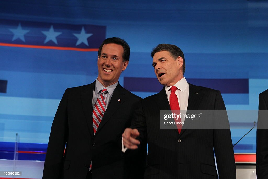 Republican presidential candidates former U.S. Senator <a gi-track='captionPersonalityLinkClicked' href=/galleries/search?phrase=Rick+Santorum&family=editorial&specificpeople=212911 ng-click='$event.stopPropagation()'>Rick Santorum</a> (R-PA) (L) and Texas Gov. <a gi-track='captionPersonalityLinkClicked' href=/galleries/search?phrase=Rick+Perry+-+Politician&family=editorial&specificpeople=175872 ng-click='$event.stopPropagation()'>Rick Perry</a> chat before the start of the Fox News Channel debate at the Sioux City Convention Center on December 15, 2011 in Sioux City, Iowa. The GOP contenders are in the final stretch of campaigning in Iowa where the January 3rd caucus is the first test the candidates must face before becoming the Republican presidential nominee.