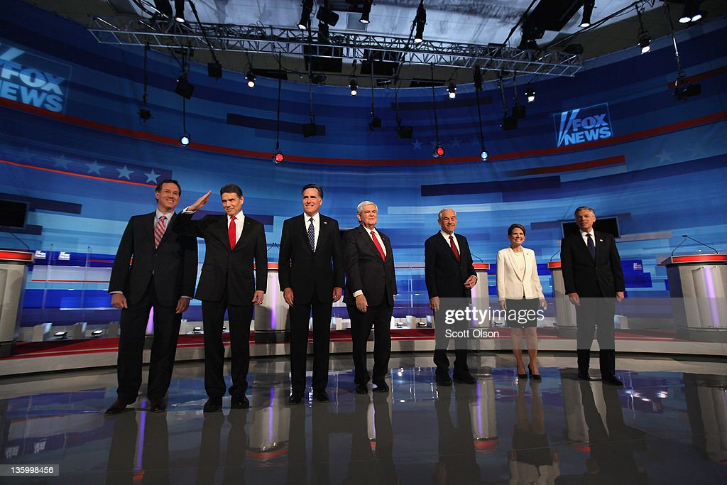 Republican presidential candidates (L-R) former U.S. Senator <a gi-track='captionPersonalityLinkClicked' href=/galleries/search?phrase=Rick+Santorum&family=editorial&specificpeople=212911 ng-click='$event.stopPropagation()'>Rick Santorum</a> (R-PA), Texas Gov. <a gi-track='captionPersonalityLinkClicked' href=/galleries/search?phrase=Rick+Perry+-+Pol%C3%ADtico&family=editorial&specificpeople=175872 ng-click='$event.stopPropagation()'>Rick Perry</a>, former Massachusetts Gov. <a gi-track='captionPersonalityLinkClicked' href=/galleries/search?phrase=Mitt+Romney&family=editorial&specificpeople=207106 ng-click='$event.stopPropagation()'>Mitt Romney</a>, former Speaker of the House <a gi-track='captionPersonalityLinkClicked' href=/galleries/search?phrase=Newt+Gingrich&family=editorial&specificpeople=202915 ng-click='$event.stopPropagation()'>Newt Gingrich</a>, U.S. Rep. <a gi-track='captionPersonalityLinkClicked' href=/galleries/search?phrase=Ron+Paul&family=editorial&specificpeople=2300665 ng-click='$event.stopPropagation()'>Ron Paul</a> (R-TX), U.S. Rep. <a gi-track='captionPersonalityLinkClicked' href=/galleries/search?phrase=Michele+Bachmann&family=editorial&specificpeople=5578664 ng-click='$event.stopPropagation()'>Michele Bachmann</a> (R-MN), and former Utah Governor Jon Huntsman Jr. are introduced during the Fox News Channel debate at the Sioux City Convention Center on December 15, 2011 in Sioux City, Iowa. The GOP contenders are in the final stretch of campaigning in Iowa where the January 3rd caucus is the first test the candidates must face before becoming the Republican presidential nominee.