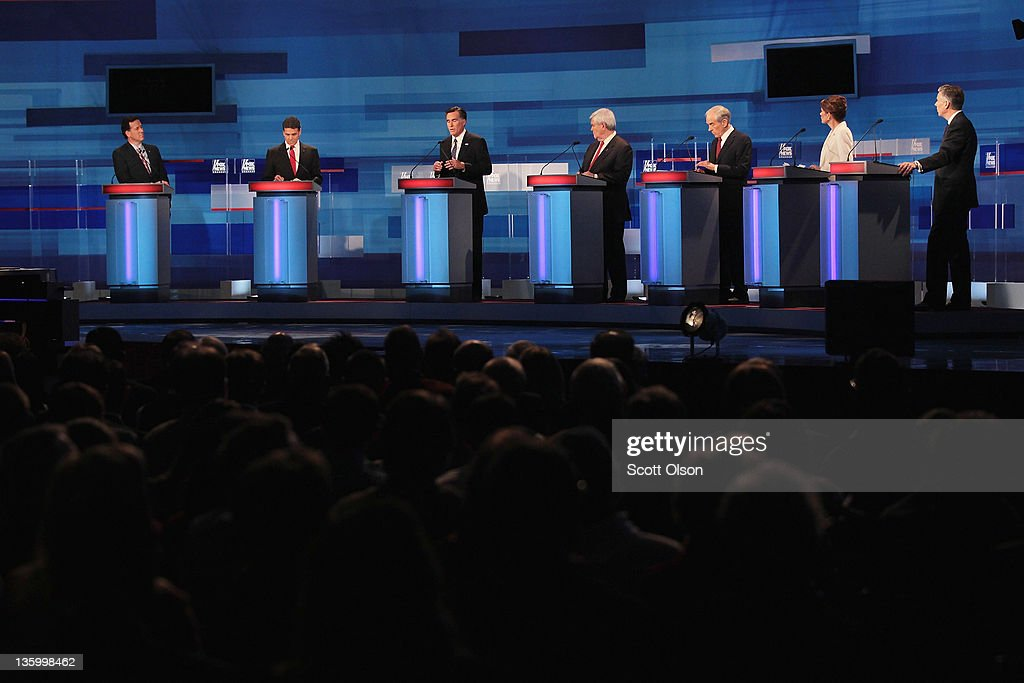 Republican presidential candidates (L-R) former U.S. Senator <a gi-track='captionPersonalityLinkClicked' href=/galleries/search?phrase=Rick+Santorum&family=editorial&specificpeople=212911 ng-click='$event.stopPropagation()'>Rick Santorum</a> (R-PA), Texas Gov. <a gi-track='captionPersonalityLinkClicked' href=/galleries/search?phrase=Rick+Perry+-+Politiker&family=editorial&specificpeople=175872 ng-click='$event.stopPropagation()'>Rick Perry</a>, former Massachusetts Gov. <a gi-track='captionPersonalityLinkClicked' href=/galleries/search?phrase=Mitt+Romney&family=editorial&specificpeople=207106 ng-click='$event.stopPropagation()'>Mitt Romney</a>, former Speaker of the House <a gi-track='captionPersonalityLinkClicked' href=/galleries/search?phrase=Newt+Gingrich&family=editorial&specificpeople=202915 ng-click='$event.stopPropagation()'>Newt Gingrich</a>, U.S. Rep. <a gi-track='captionPersonalityLinkClicked' href=/galleries/search?phrase=Ron+Paul&family=editorial&specificpeople=2300665 ng-click='$event.stopPropagation()'>Ron Paul</a> (R-TX), U.S. Rep. <a gi-track='captionPersonalityLinkClicked' href=/galleries/search?phrase=Michele+Bachmann&family=editorial&specificpeople=5578664 ng-click='$event.stopPropagation()'>Michele Bachmann</a> (R-MN), and former Utah Governor Jon Huntsman Jr. field questions during the Fox News Channel debate at the Sioux City Convention Center on December 15, 2011 in Sioux City, Iowa. The GOP contenders are in the final stretch of campaigning in Iowa where the January 3rd caucus is the first test the candidates must face before becoming the Republican presidential nominee.