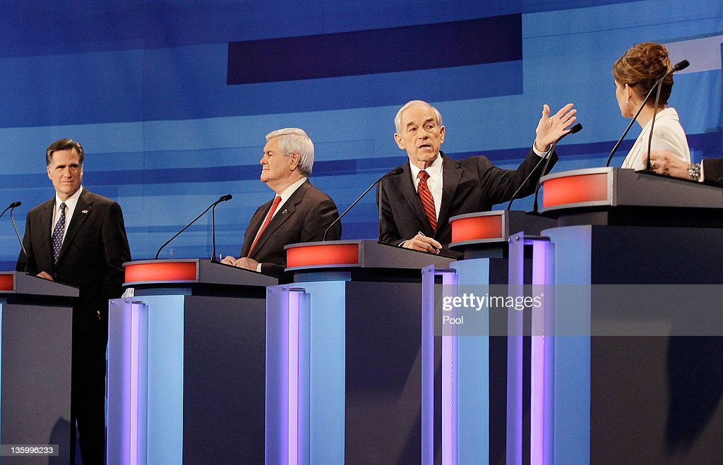 Republican presidential candidates from left, former Massachusetts Gov. Mitt Romney, former House Speaker Newt Gingrich, Rep. Ron Paul, (R-TX), and Rep. Michele Bachmann, (R-MN), participate in a Republican presidential debate at the Sioux City Convention Center on December 15, 2011 in Sioux City, Iowa. The GOP contenders are in the final stretch of campaigning in Iowa where the January 3rd caucus is the first test the candidates must face before becoming the Republican presidential nominee.