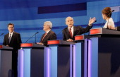 Republican presidential candidates from left former Massachusetts Gov Mitt Romney former House Speaker Newt Gingrich Rep Ron Paul and Rep Michele...