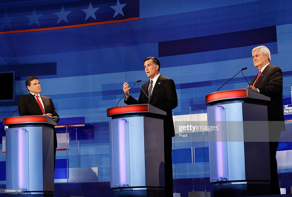 Republican presidential candidates from left, former Pennsylvania Sen. Rick Santorum, Texas Gov. Rick Perry, and former Massachusetts Gov. Mitt Romney, participate in a debate at the Sioux City Convention Center on December 15, 2011 in Sioux City, Iowa. The GOP contenders are in the final stretch of campaigning in Iowa where the January 3rd caucus is the first test the candidates must face before becoming the Republican presidential nominee.