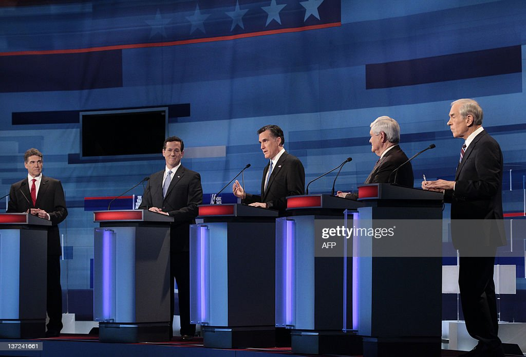 Republican presidential candidates, from left to right: Texas Gov. Rick Perry; former Pennsylvania Sen. Rick Santorum; former Massachusetts Gov. Mitt Romney; former House Speaker Newt Gingrich; Rep. Ron Paul, R-Texas; stand at their podiums during the South Carolina Republican presidential candidates debate in Myrtle Beach, SC, Monday, January 16, 2012. AFP PHOTO / Pool / Charles Dharapak