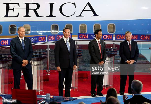 Republican presidential candidates George Pataki Rick Santorum Louisiana Gov Bobby Jindal and US Senator Lindsey Graham stand onstage during the...