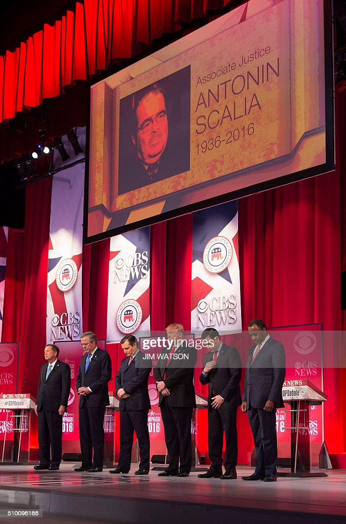 Republican presidential candidates hold a moment of silence for Supreme Court Justice Antonin Scalia, who passed away earlier in the day, during the CBS News Republican Presidential Debate in Greenville, South Carolina, February 13, 2016. From left are: John Kasich, Jeb Bush, Ted Cruz, Donald Trump, Marco Rubio, and Ben Carson. / AFP / JIM WATSON