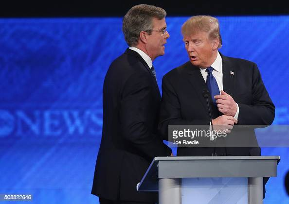 Republican presidential candidates Jeb Bush and Donald Trump talk following the Republican presidential debate at St Anselm College February 6 2016...