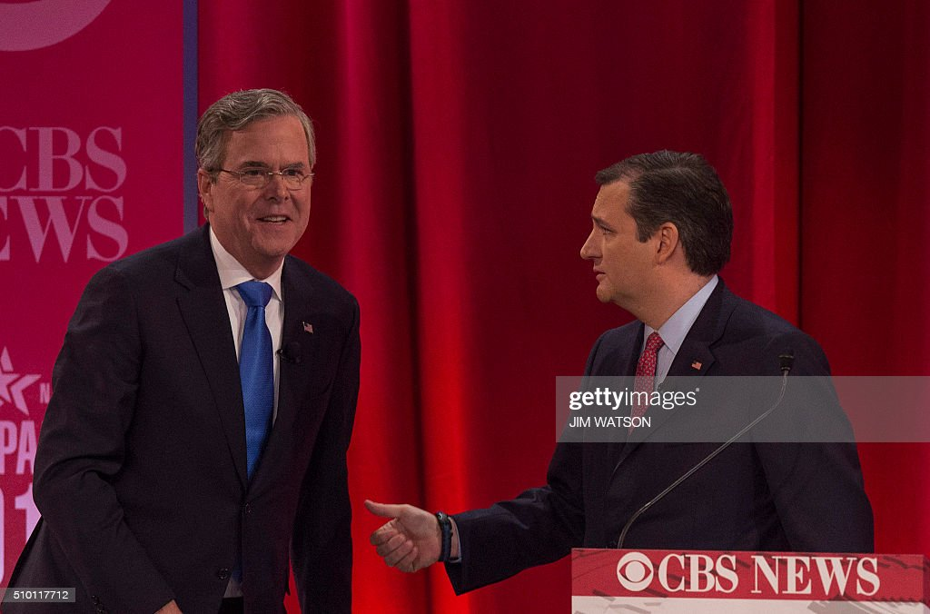 Republican presidential candidates Jeb Bush (L) and Ted Cruz (R) talk following the CBS News Republican Presidential Debate in Greenville, South Carolina, February 13, 2016. / AFP / JIM WATSON