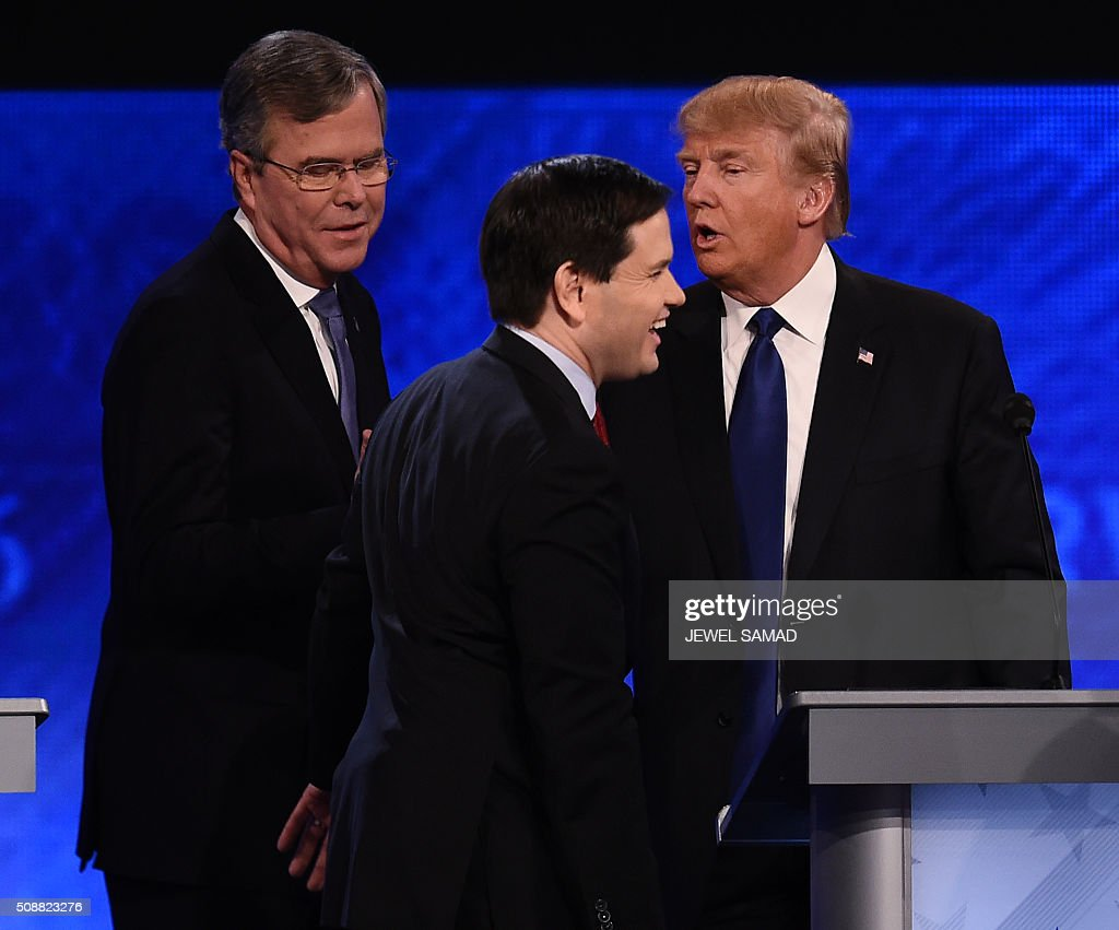 Republican presidential candidates Jeb Bush (L), Marco Rubio (C) and Donald Trump (R) greet one another following the Republican Presidential Candidates Debate on February 6, 2016 at St. Anselm's College Institute of Politics in Manchester, New Hampshire. Seven Republicans campaigning to be US president are in a fight for survival in their last debate Saturday before the New Hampshire primary, battling to win over a significant number of undecided voters. / AFP / Jewel Samad