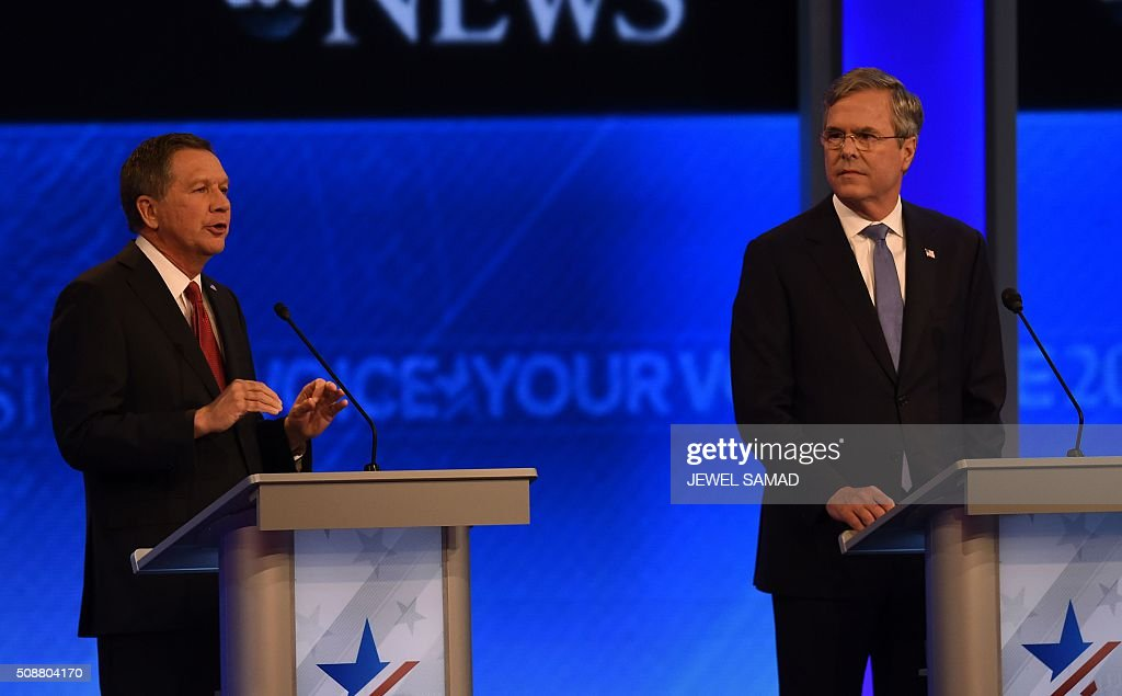 Republican presidential candidates John Kasich (L) and Jeb Bush participate in the Republican Presidential Candidates Debate on February 6, 2016 at St. Anselm's College Institute of Politics in Manchester, New Hampshire. Seven Republicans campaigning to be US president are in a fight for survival in their last debate Saturday before the New Hampshire primary, battling to win over a significant number of undecided voters. / AFP / Jewel Samad