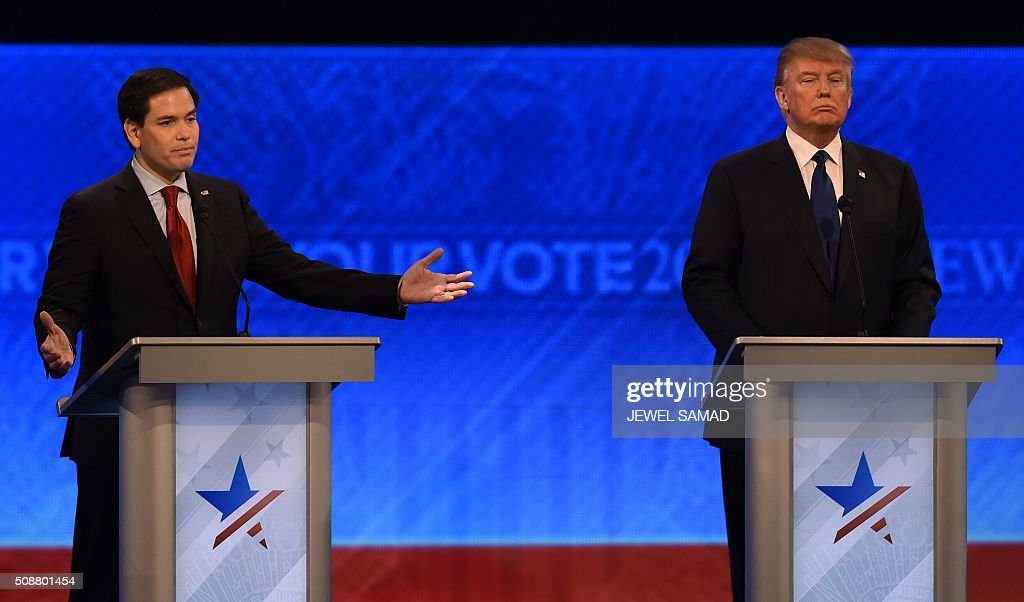 Republican presidential candidates Marco Rubio (L) and Donald Trump (R) participate in the Republican Presidential Candidates Debate on February 6, 2016 at St. Anselm's College Institute of Politics in Manchester, New Hampshire. Seven Republicans campaigning to be US president are in a fight for survival in their last debate Saturday before the New Hampshire primary, battling to win over a significant number of undecided voters. / AFP / Jewel Samad