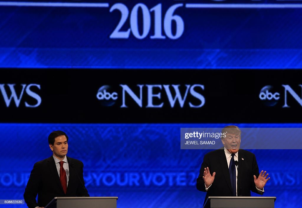 Republican presidential candidates Marco Rubio (L) and Donald Trump participate in the Republican Presidential Candidates Debate February 6, 2016 at St. Anselm's College Institute of Politics in Manchester, New Hampshire. Seven Republicans campaigning to be US president are in a fight for survival in their last debate Saturday before the New Hampshire primary, battling to win over a significant number of undecided voters. / AFP / Jewel Samad