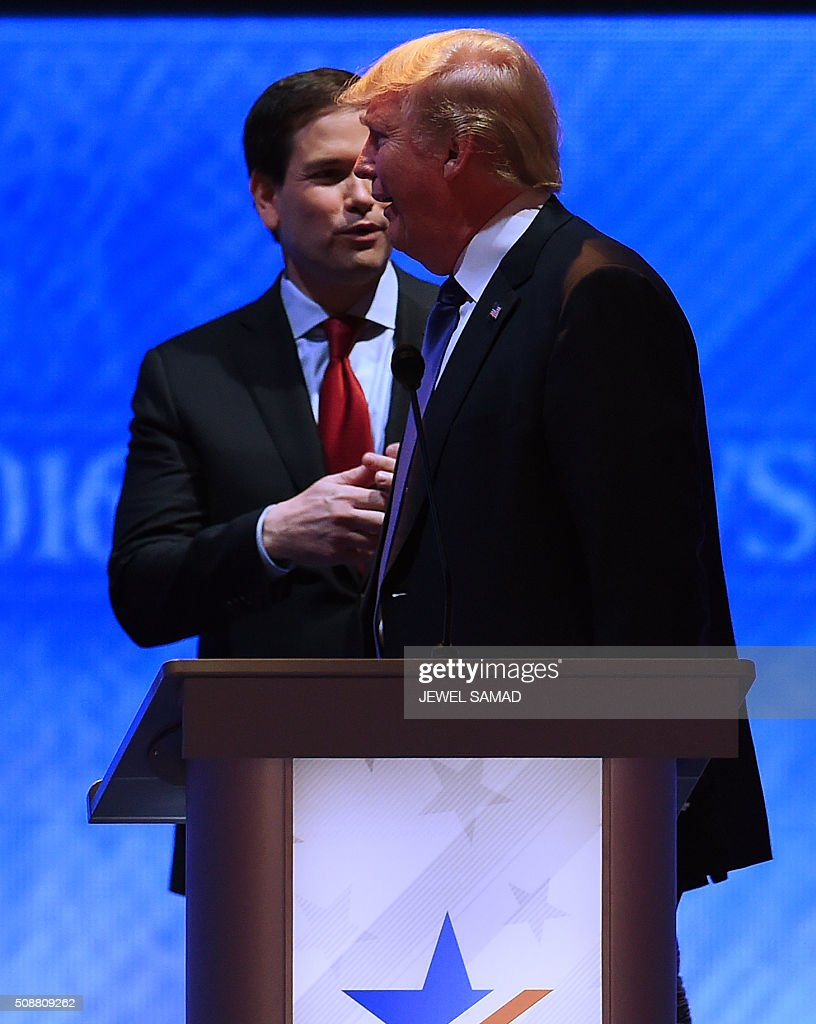 Republican presidential candidates Marco Rubio (L) and Donald Trump talk during a break in the Republican Presidential Candidates Debate February 6, 2016 at St. Anselm's College Institute of Politics in Manchester, New Hampshire. Seven Republicans campaigning to be US president are in a fight for survival in their last debate Saturday before the New Hampshire primary, battling to win over a significant number of undecided voters. / AFP / Jewel Samad