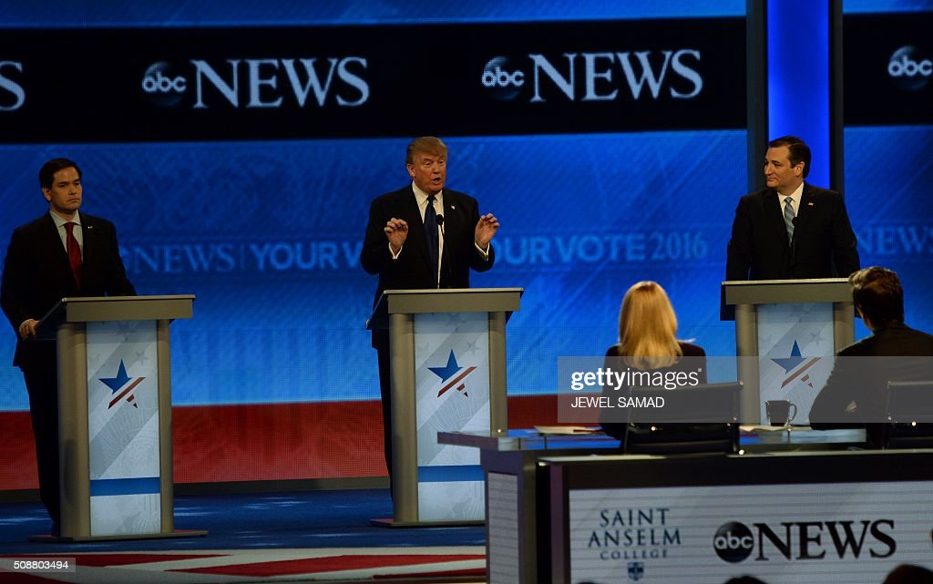 Republican presidential candidates Marco Rubio (L), Donald Trump (C) and Ted Cruz (R) participate in the Republican Presidential Candidates Debate on February 6, 2016 at St. Anselm's College Institute of Politics in Manchester, New Hampshire. Seven Republicans campaigning to be US president are in a fight for survival in their last debate Saturday before the New Hampshire primary, battling to win over a significant number of undecided voters. / AFP / JEWEL SAMAD