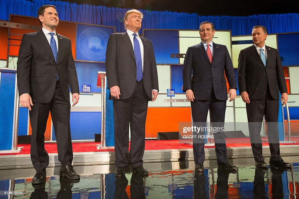 US Republican Presidential candidates Marco Rubio Donald Trump Ted Cruz and John Kasich pose for a photo at start of the Republican Presidential...