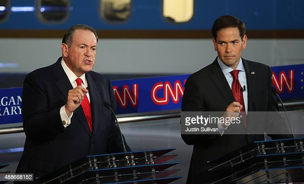 Republican presidential candidates Mike Huckabee and Marco Rubio take part in the presidential debates at the Reagan Library on September 16 2015 in...