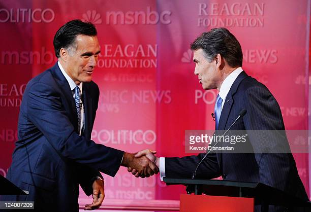Republican presidential candidates Mitt Romney shakes hands with Texas Gov Rick Perry after the Ronald Reagan Centennial GOP Presidential Primary...