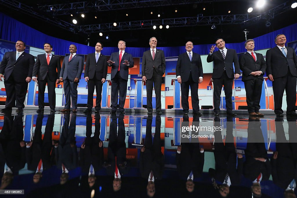 Republican presidential candidates (L-R) New Jersey Gov. <a gi-track='captionPersonalityLinkClicked' href=/galleries/search?phrase=Chris+Christie&family=editorial&specificpeople=6480114 ng-click='$event.stopPropagation()'>Chris Christie</a>, Sen. <a gi-track='captionPersonalityLinkClicked' href=/galleries/search?phrase=Marco+Rubio+-+Pol%C3%ADtico&family=editorial&specificpeople=11395287 ng-click='$event.stopPropagation()'>Marco Rubio</a> (R-FL), <a gi-track='captionPersonalityLinkClicked' href=/galleries/search?phrase=Ben+Carson&family=editorial&specificpeople=3233819 ng-click='$event.stopPropagation()'>Ben Carson</a>, Wisconsin Gov. <a gi-track='captionPersonalityLinkClicked' href=/galleries/search?phrase=Scott+Walker+-+Pol%C3%ADtico&family=editorial&specificpeople=7511934 ng-click='$event.stopPropagation()'>Scott Walker</a>, Donald Trump, <a gi-track='captionPersonalityLinkClicked' href=/galleries/search?phrase=Jeb+Bush&family=editorial&specificpeople=171487 ng-click='$event.stopPropagation()'>Jeb Bush</a>, <a gi-track='captionPersonalityLinkClicked' href=/galleries/search?phrase=Mike+Huckabee&family=editorial&specificpeople=226521 ng-click='$event.stopPropagation()'>Mike Huckabee</a>, Sen. <a gi-track='captionPersonalityLinkClicked' href=/galleries/search?phrase=Ted+Cruz&family=editorial&specificpeople=7222093 ng-click='$event.stopPropagation()'>Ted Cruz</a> (R-TX), Sen. <a gi-track='captionPersonalityLinkClicked' href=/galleries/search?phrase=Rand+Paul&family=editorial&specificpeople=6939188 ng-click='$event.stopPropagation()'>Rand Paul</a> (R-KY) and <a gi-track='captionPersonalityLinkClicked' href=/galleries/search?phrase=John+Kasich&family=editorial&specificpeople=1315571 ng-click='$event.stopPropagation()'>John Kasich</a> take the stage for the first prime-time presidential debate hosted by FOX News and Facebook at the Quicken Loans Arena August 6, 2015 in Cleveland, Ohio. The top-ten GOP candidates were selected to participate in the debate based on their r