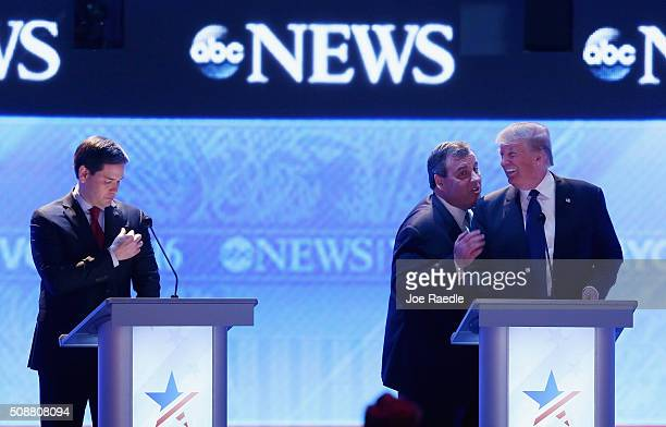 Republican presidential candidates New Jersey Governor Chris Christie and Donald Trump visit as Sen Marco Rubio stands close by during a commercial...