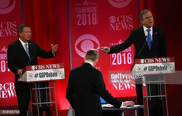 Republican presidential candidates Ohio Governor John Kasich and Jeb Bush participate in a CBS News GOP Debate February 13 2016 at the Peace Center...