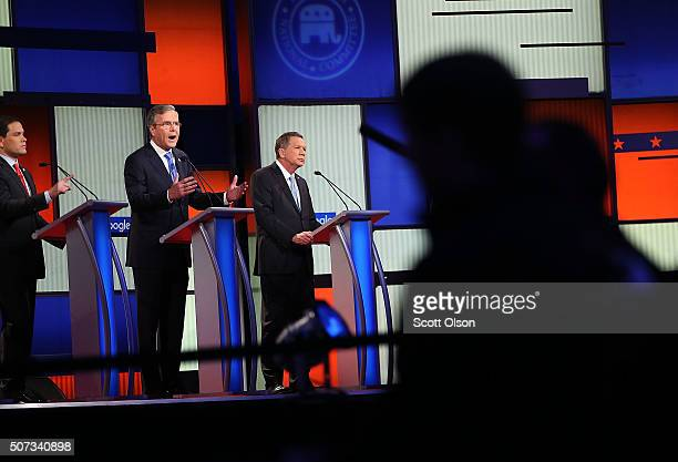 Republican presidential candidates Ohio Governor John Kasich Jeb Bush and Sen Marco Rubio participate in the Fox News Google GOP Debate January 28...