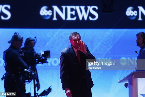Republican presidential candidates Ohio Governor John Kasich talks to an audience member during a commercial break in the Republican presidential...