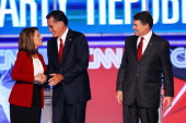 Republican presidential candidates Rep Michele Bachmann Mitt Romney and Gov Rick Perry are introduced for a debate sponsored by CNN and The Tea Party...