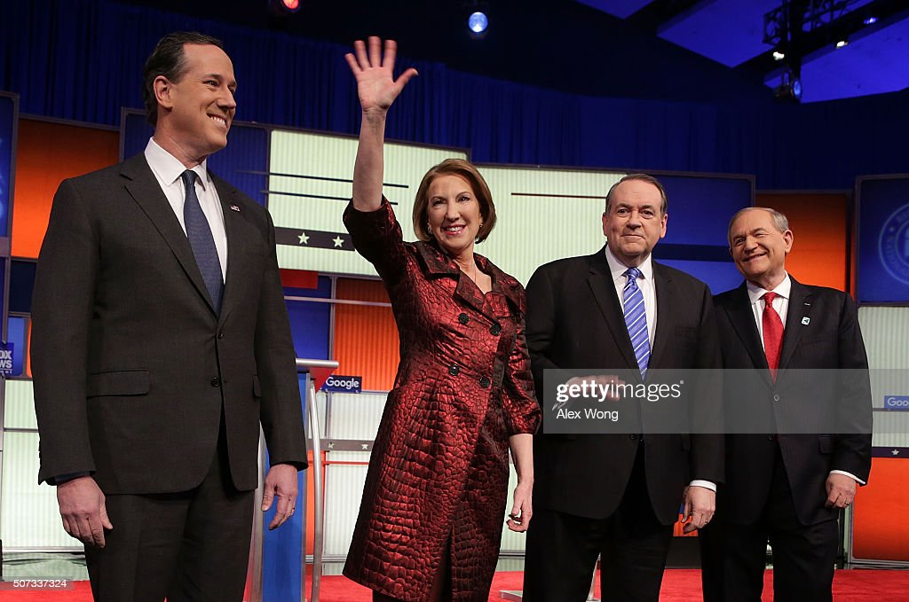 Republican presidential candidates (L-R) Rick Santorum, Carly Fiorina, Mike Huckabee and Jim Gilmore pose for photographers prior to the Fox News - Google GOP Debate January 28, 2016 at the Iowa Events Center in Des Moines, Iowa. Residents of Iowa will vote for the Republican nominee at the caucuses on February 1.