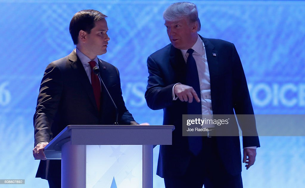 Republican presidential candidates Sen Marco Rubio and Donald Trump visit during commercial break in the Republican presidential debate at St Anselm...
