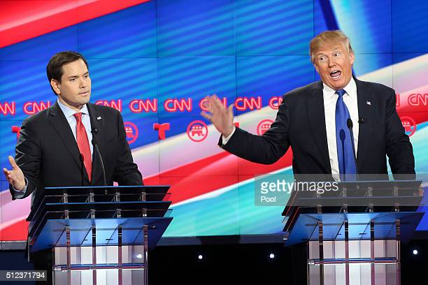 Republican presidential candidates Sen Marco Rubio and Donald Trump argue during the Republican presidential debate at the Moores School of Music at...