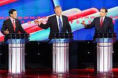 Republican presidential candidates Sen Marco Rubio Donald Trump and Sen Ted Cruz listen as answers a question during the Republican presidential...