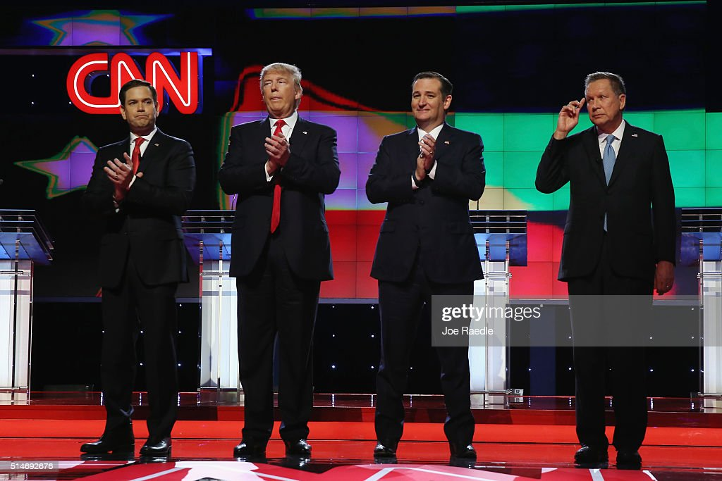 Republican presidential candidates, Sen. Marco Rubio (R-FL), Donald Trump, Sen. Ted Cruz (R-TX), and Ohio Gov. John Kasich applaud after the performance of the national anthem before the CNN, Salem Media Group, The Washington Times Republican Presidential Primary Debate on the campus of the University of Miami on March 10, 2016 in Coral Gables, Florida. The candidates continue to campaign before the March 15th Florida primary.