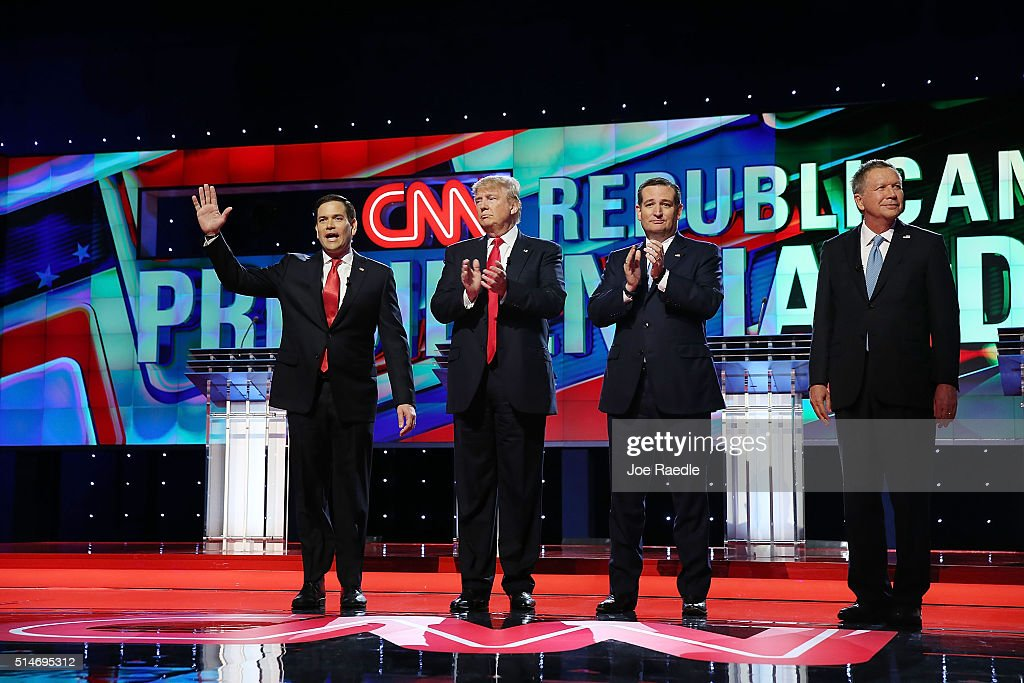 Republican presidential candidates, Sen. Marco Rubio (R-FL), Donald Trump, Sen. Ted Cruz (R-TX), and Ohio Gov. John Kasich arrive for the start of the CNN, Salem Media Group, The Washington Times Republican Presidential Primary Debate on the campus of the University of Miami on March 10, 2016 in Coral Gables, Florida. The candidates continue to campaign before the March 15th Florida primary.