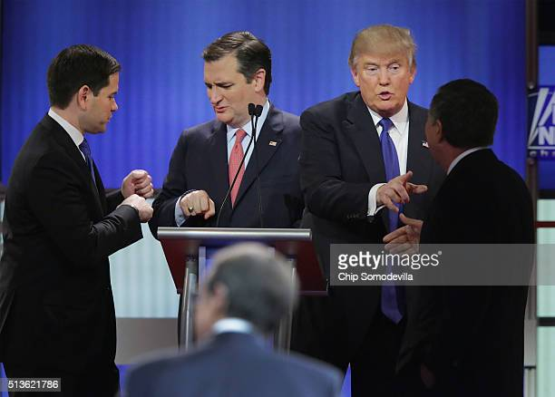 Republican presidential candidates Sen Marco Rubio Sen Ted Cruz Donald Trump and Ohio Gov John Kasich greet each following a debate sponsored by Fox...