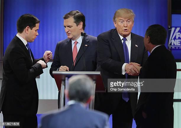 Republican presidential candidates Sen Marco Rubio Sen Ted Cruz Donald Trump and Ohio Gov John Kasich greet each following a debate sponsored by Fox...