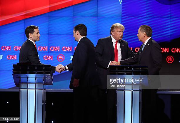 Republican presidential candidates Sen Marco Rubio Sen Ted Cruz Donald Trump and Ohio Gov John Kasich shake hands at the end of their debate during...