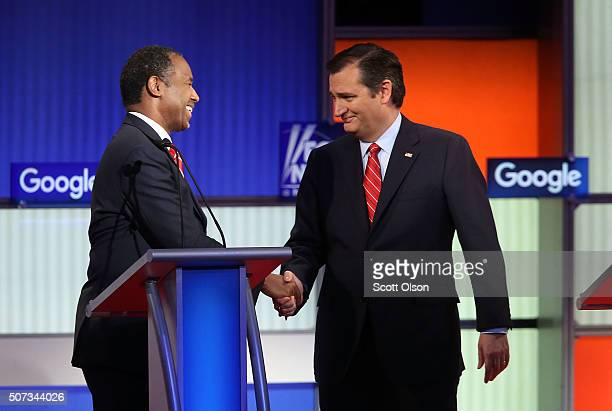 Republican presidential candidates Sen Ted Cruz shakes hands with Ben Carson after the Fox News Google GOP Debate January 28 2016 at the Iowa Events...