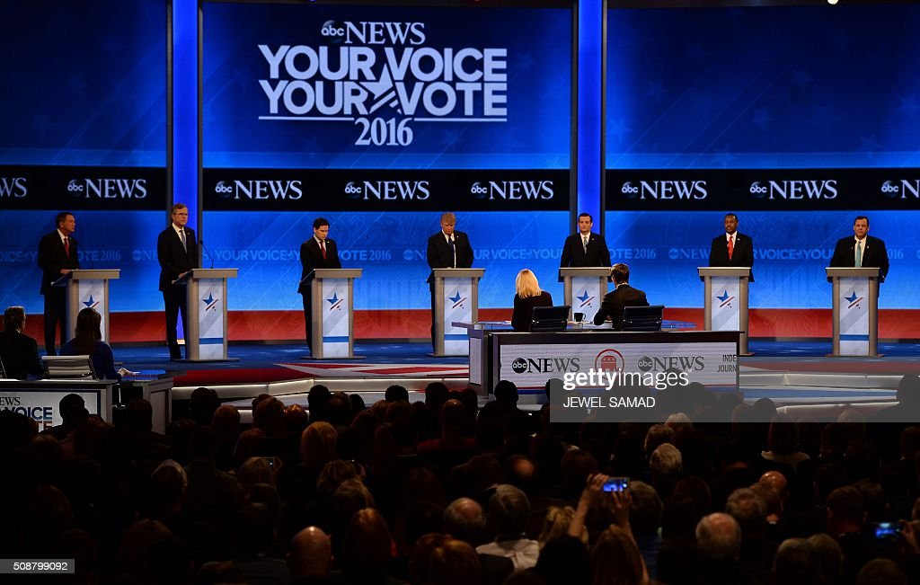 Republican presidential candidates stand at their respective podiums during the Republican Presidential Candidates Debate on February 6, 2016 at St. Anselm's College Institute of Politics in Manchester, New Hampshire. From left are: John Kasich, Jeb Bush, Marco Rubio, Donald Trump, Ted Cruz, Ben Carson, and Chris Christie. Seven Republicans campaigning to be US president are in a fight for survival in their last debate Saturday before the New Hampshire primary, battling to win over a significant number of undecided voters. / AFP / JEWEL SAMAD