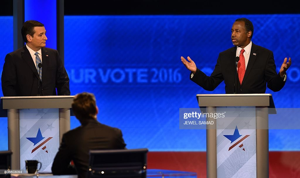 Republican presidential candidates Ted Cruz (L) and Ben Carson (R) participate in the Republican Presidential Candidates Debate on February 6, 2016 at St. Anselm's College Institute of Politics in Manchester, New Hampshire. Seven Republicans campaigning to be US president are in a fight for survival in their last debate Saturday before the New Hampshire primary, battling to win over a significant number of undecided voters. / AFP / Jewel Samad