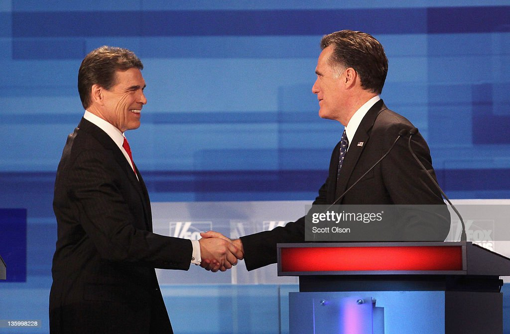 Republican presidential candidates Texas Gov. Rick Perry (L) and former Massachusetts Gov. Mitt Romney chat following the Fox News Channel debate at the Sioux City Convention Center on December 15, 2011 in Sioux City, Iowa. The GOP contenders are in the final stretch of campaigning in Iowa where the January 3rd caucus is the first test the candidates must face before becoming the Republican presidential nominee.