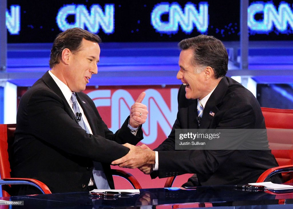 Republican presidential candidates U.S. Rep. former U.S. Sen. Rick Santorum (L) and former Massachusetts Gov. Mitt Romney talk after participating in a debate sponsored by CNN and the Republican Party of Arizona at the Mesa Arts Center February 22, 2012 in Mesa, Arizona. The debate is the last one scheduled before voters head to the polls in Michigan and Arizona's primaries on February 28 and Super Tuesday on March 6.